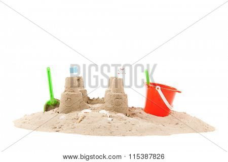 Beach with sand, fishing net and toys isolated over white background