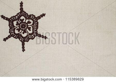 Crochet lace on linen background
