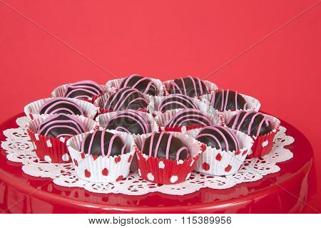 Chocolate cake balls in red and white polka dot mini cup cake liners