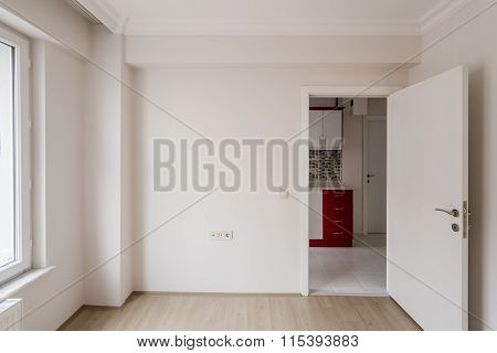 Bright Small Room Of New Apartment With One Open Door