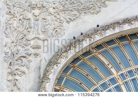 Pigeons On Old City Building. Three Black Pigeons Are Sitting On White Old City Building And Are Wat