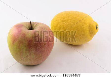Big beautiful ripe apples and lemon