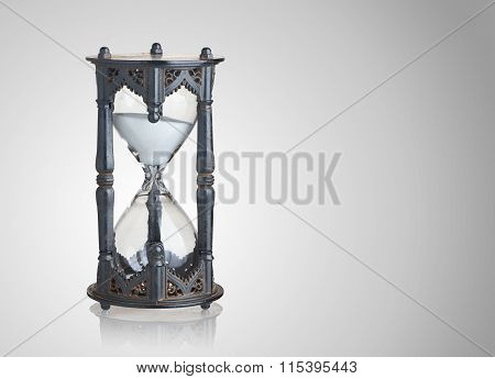 Vintage Hourglass On Gray Background