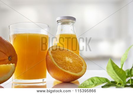 Squeezed Orange Juice In Glass On White Kitchen Horizontal Composition