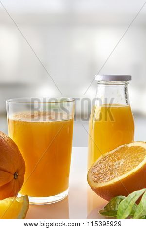 Squeezed Orange Juice In Glass On White Kitchen Vertical Composition