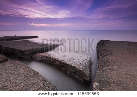 Rocks on the beach skyline during sunrise