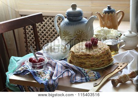 Pancakes With Sour Cream, A Fresh Berry And Tea.