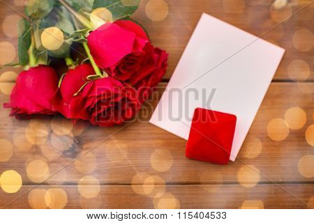 close up of gift box, red roses and greeting card