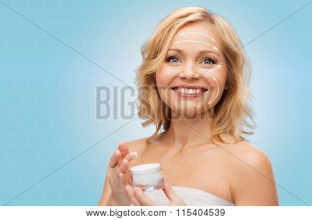 happy woman with cream jar