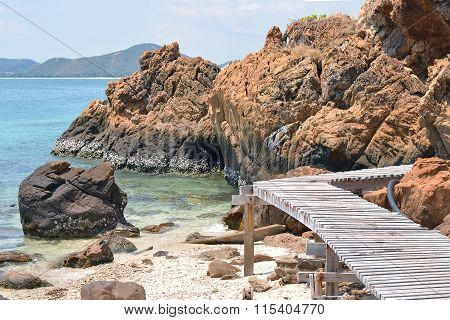 Wooden Footbridge Seaside With Rock On The Beach; Koh Kham, Chonburi