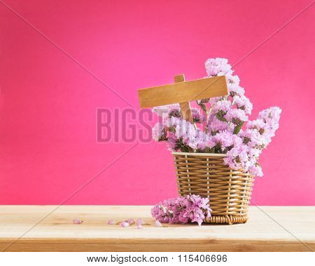 Sweet Statice Flower In Basket With Blank Wooden Label On Red Pink Background And Wooden Table , Rom
