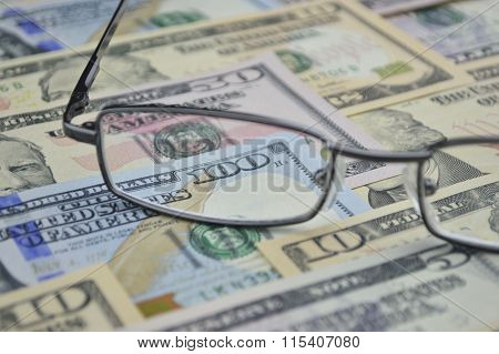 Glasses And Dollar Bank Note Money; Financial Concept