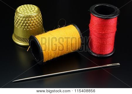 Threads With Needle And Thimble