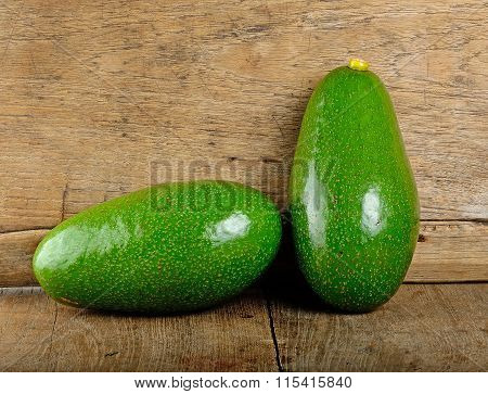 Avocado Fruit On The Wooden Background
