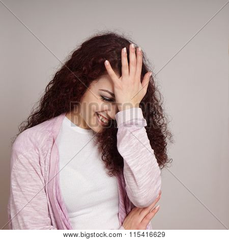 embarrassed young woman facepalm