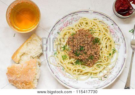 Spaghetti Bolognese Pasta In A Dish And Wine