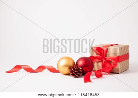 Isolated Brown Cardboard Box, Bow And Ribbon With Christmas Decoration