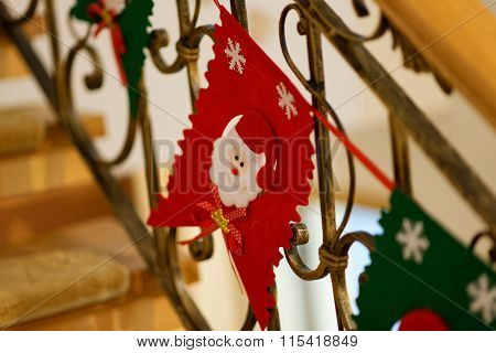 Home Christmas Decoration With Santa Claus Face Hanging On A Fence