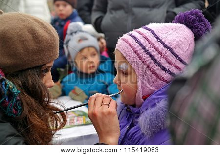 Gatchina, Leningrad Region, Russia - March 2, 2014:  Girl Doing A Children's Make-up, Perhaps It Is
