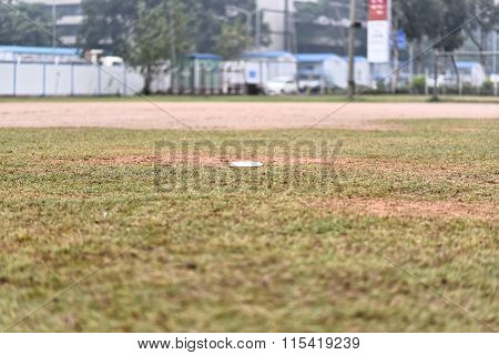 Flying Disc Laying On A Grass Field
