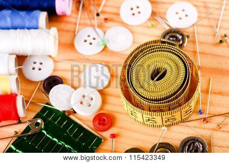 Tape Measure With Accessories On Wooden Board
