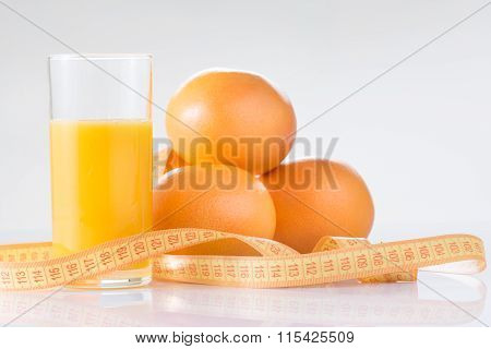 Oranges, fresh juice and measuring tape.