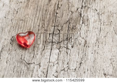 Red Heart On A Wooden Table. Background Valentine's Day