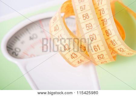 Measuring tape on top of scales.