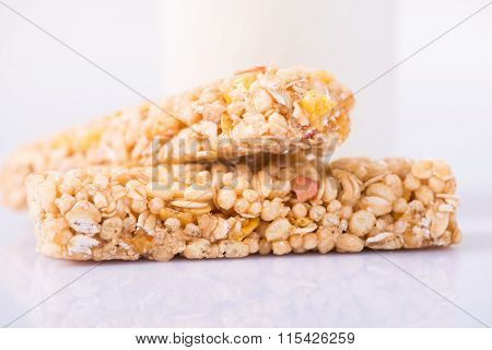 Two granola bars are on the surface.