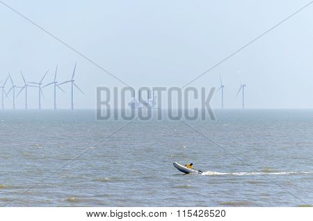 speed boat an offshore wind farm