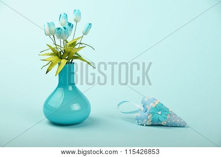 Toy Heart And Vase With Silk Tulips On Blue Background