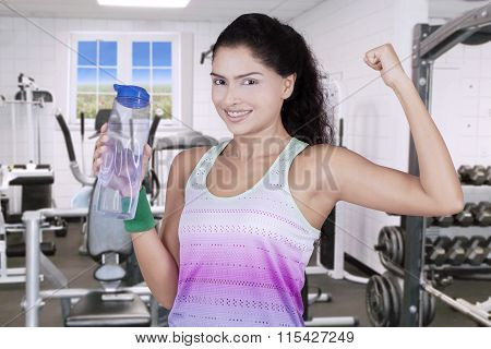 Attractive Woman Holds Beverage At Gym