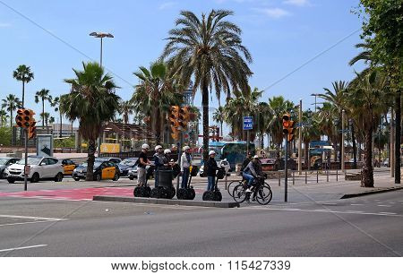 Barcelona, Spain - May 17, 2014: Tourists Sightseeing On Segway Tour Of Barcelona