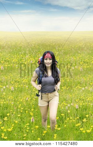 Beautiful Female Hiker Walks On Meadow