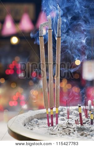 Burning Incense Sticks In The Temple