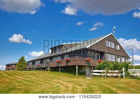 Coastal Wooden Houses In Norway