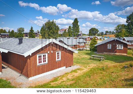 Coastal Wooden Houses In Norway In Cloudy Summer Day