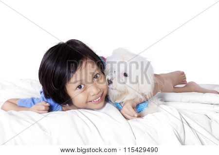 Cute Girl And Maltese Dog On Bed