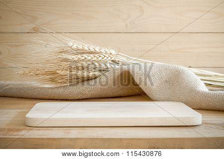 Wooden Tray And Spikelets Wheat With Sackcloth On Wooden Background.