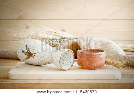 Japanese Sake Drinking Set On Wood Texture Background.