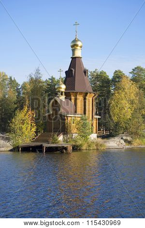 The wooden Church of the Apostle Andrew on Vuoksa autumn day. Leningrad region