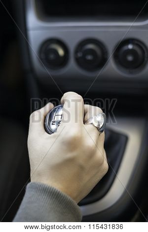 Young woman holding gearshift