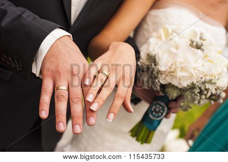 Newlyweds hands.