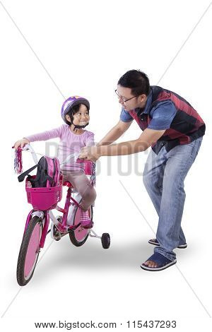 Little Girl Ride Bicycle With Dad In Studio