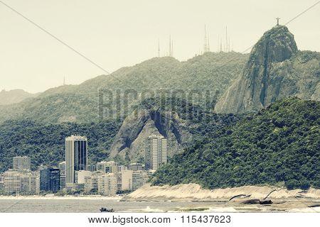 Copacabana Beach and Christ, symbol of Rio de Janeiro, standing on top of Corcovado Hill, Rio de Jan