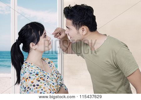 Mad Man Scolding His Wife At Home