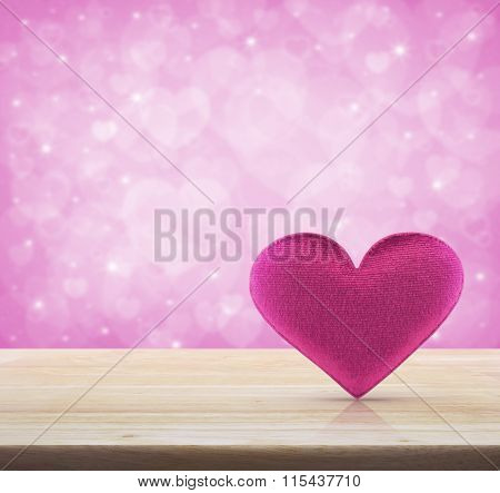 Fabric Pink Heart Shape On Wooden Table Over Light Pink Heart Bokeh Background, Valentine Concept