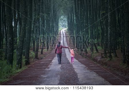 Man And Daughter Walking In The Forest