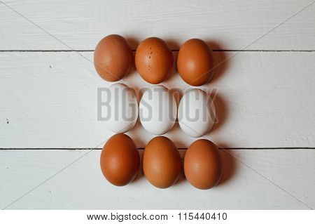 Beautiful Light And Dark Chicken Eggs On White Old Wooden Table