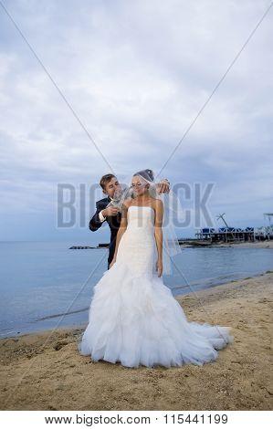 Beautiful newlyweds by the seashore.